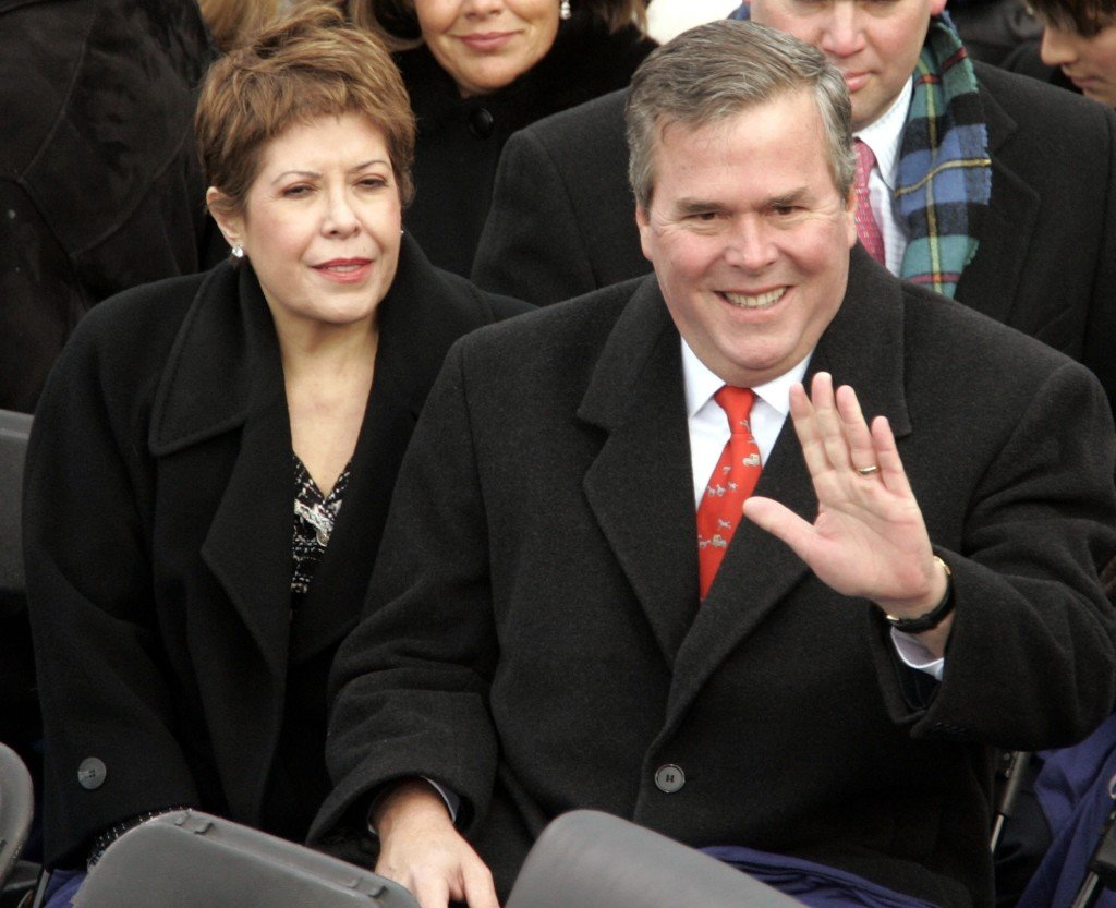 WASHINGTON - JANUARY 20: Florida Gov. Jeb Bush and his wife Columba wave to the crowd as they are seated on the inaugural stage January 20, 2005 in Washington, D.C. U.S. President George W. Bush will be sworn in for a second term during the inaugural ceremony. (Photo by Mark Wilson/Getty Images)